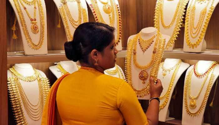 Gold falls by Rs 32 to Rs 49,986 per 10 gram