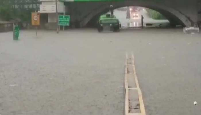 DTC bus gets stuck in waterlogged road in Delhi, passengers rescued by DFS personnel - Watch