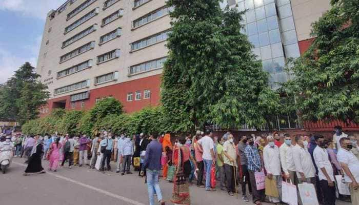 Long queues outside hospitals in Delhi, social distancing rules flouted amid spike in COVID cases
