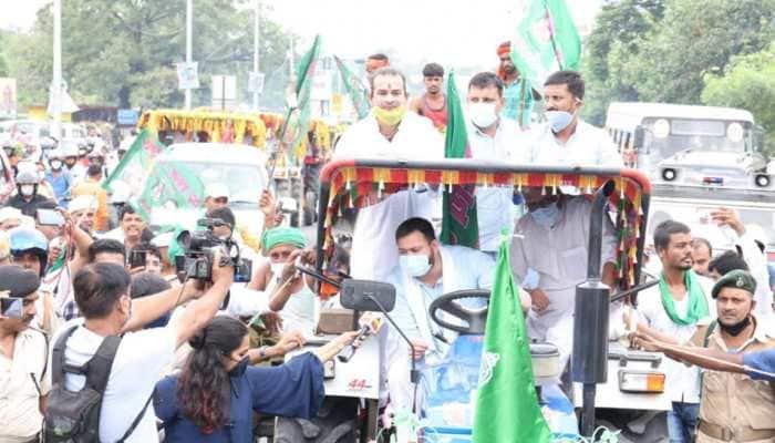 RJD leader Tejashwi Yadav drives tractor, brother Tej Pratap Yadav sits atop it during protest over Farm Bills: Watch