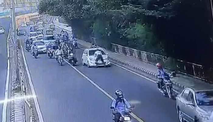 Delhi traffic policeman dragged on car bonnet for a few metres, driver arrested - WATCH