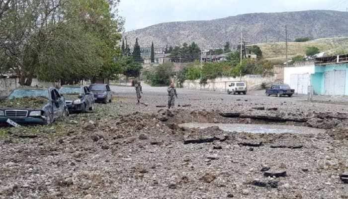 Nagorno-Karabakh ceasefire marred by accusations of new attacks, aid delay