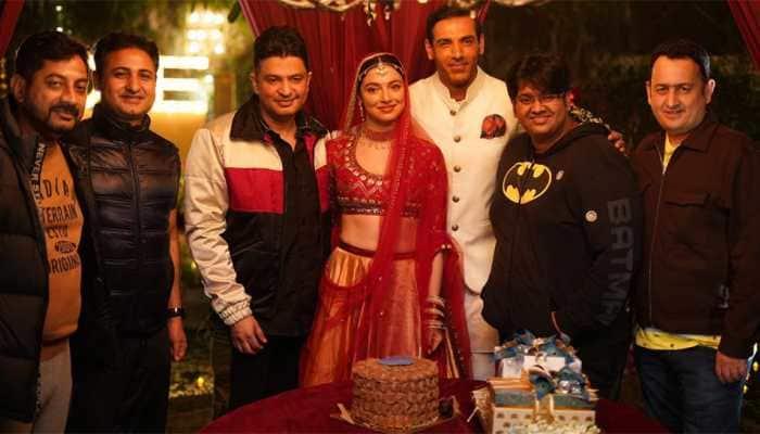 Dressed in red lehenga-choli Divya Khosla Kumar celebrates birthday with 'Satyamev Jayate 2' cast - In pics