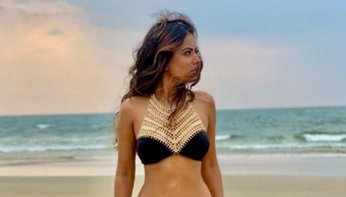Naagin actress Nia Sharma oozes oomph in a black and golden bikini, steams up social media!