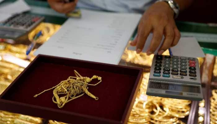 Gold rises Rs 514 to Rs 50,297 per 10 gram; silver zooms by Rs 2,249