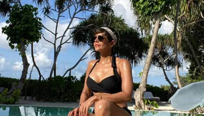 Mandira Bedi flaunts her washboard abs in throwback bikini pic; misses sun, sea and sand!