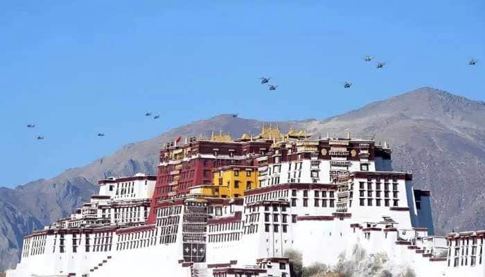 Exclusive: Rattled by protests in Tibet, China performs military air drill over Lhasa