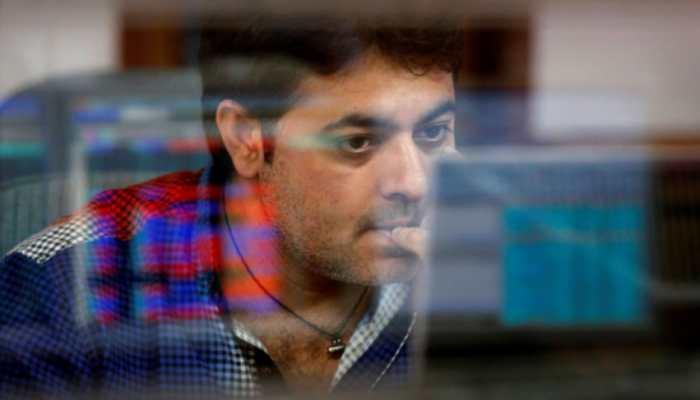 Sensex slips 81 points; Nifty holds 14,100 level