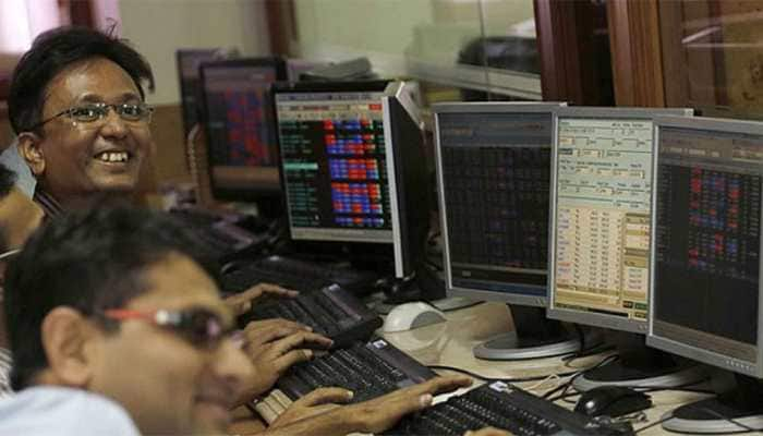 Markets end at fresh record highs; Sensex rallies nearly 690 points, Nifty tops 14,350