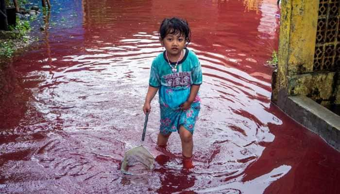 Indonesian village turns red as floods hit batik factory- See pic