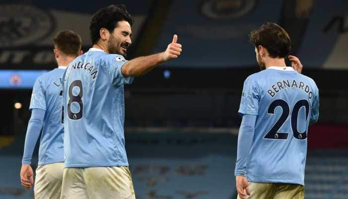 Relentless Manchester City march on, Liverpool lose again