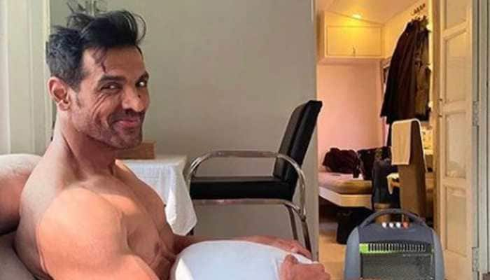 John Abraham ditches clothes, covers-up with a pillow in this new pic from movie sets!