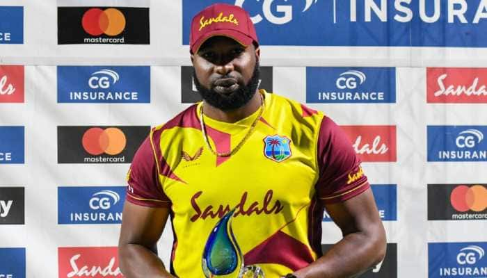 West Indies skipper Kieron Pollard is awarded the trophy after winning the T20 series against Sri Lanka 2-1. (Photo: Cricket West Indies)