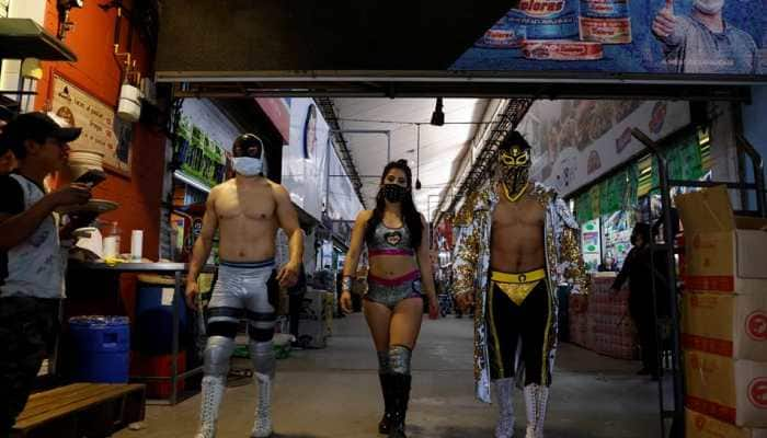 Put on a mask: Lucha libre wrestlers promote COVID-19 safety in busy Mexico markets