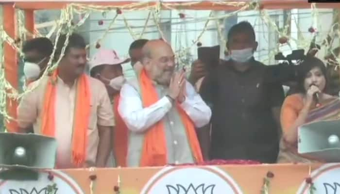 West Bengal Assembly election: Amit Shah eats lunch at rickshaw puller's house in Domjur, holds roadshow in Singur
