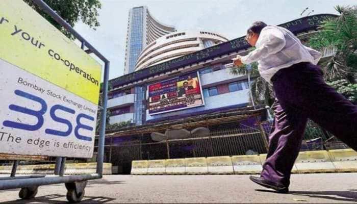 Sensex ends marginally higher; Nifty stays below 14,700; metals, auto slip