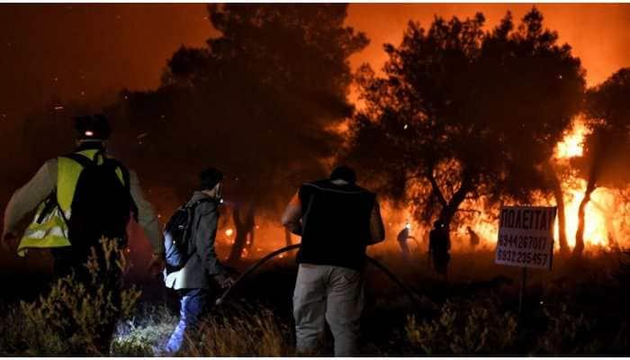 Greek firefighters try to narrow down blaze near Athens