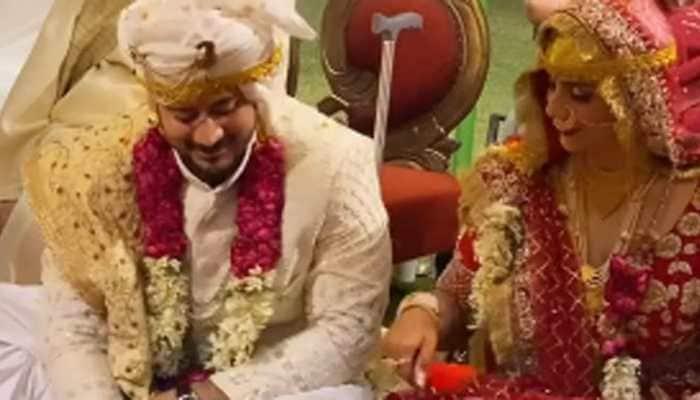 Viral video: This Kashmiri dulha-dulhan play 'flip the bottle' during 'rest time' amid shaadi rituals - Watch