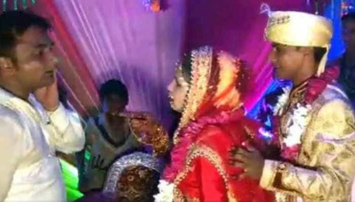 Viral video: Dulhan ka 'Thappad'! Bride slaps a man on-stage who tries to lift her, 'clueless' groom has an epic reaction - Watch