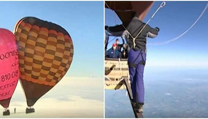 Man walks between hot air balloons suspended over 6,500 metres high, watch thrilling video