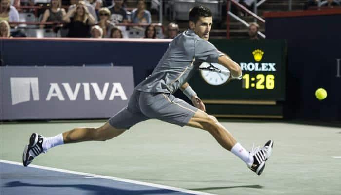 Novak Djokovic holds off Ernests Gulbis, Rafael Nadal exits in Montreal